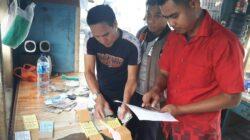 Tim Sapu Bersih Pungutan Liar (Saber Pungli) Kota Solok mengamankan barang bukti dari dua orang petugas TPR Dinas Perhubungan (Dishub) Kota Solok pada 31 Januari 2018, dini hari yang kedapatan melakukan Pungli. Foto : Istimewa